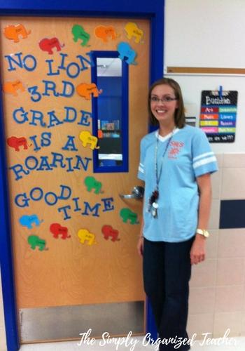 Kelly standing in front of classroom door.